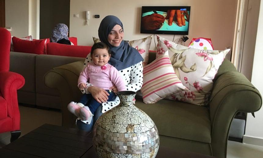Rawabi resident Mai Alzarou and her nine-month old daughter.