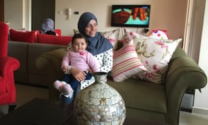 Rawabi resident Mai Alzarou and her nine-month old daughter.