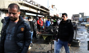 Iraqis gather at the site of the suicide bomb attacks at Tayran Square in central Baghdad.