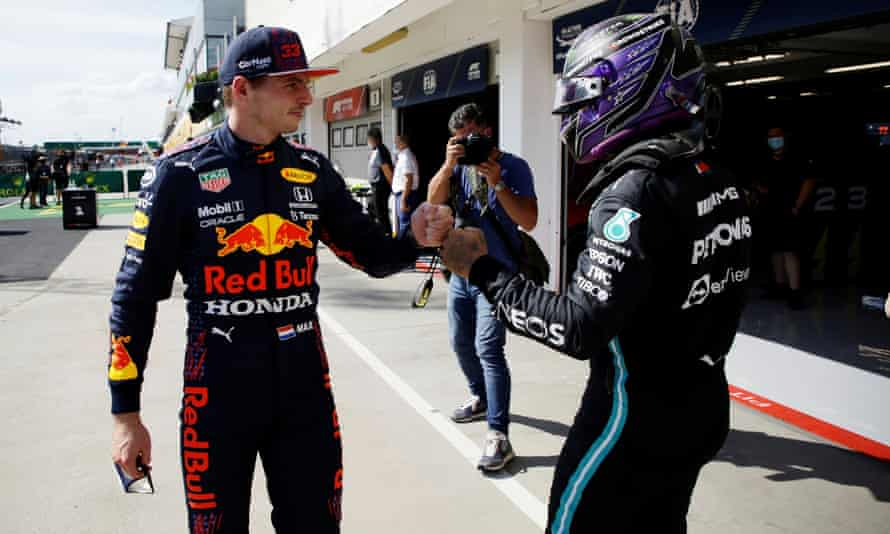 Third placed qualifier Max Verstappen bumps fists with Lewis Hamilton after the Mercedes driver took pole position, the 101st of his F1 career.