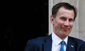 Britain's Health Secretary Jeremy Hunt leaves Number 10 Downing Street