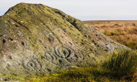 Cup and ring marks on the ancient Badger Stone on Ilkley Moor.