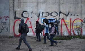 People leaving the Calais refugee camp on 24 October 2016