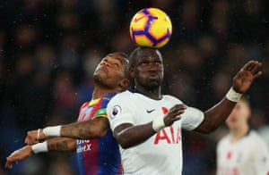 Jordan Ayew of Crystal Palace battles for possession with Moussa Sissoko of Tottenham.