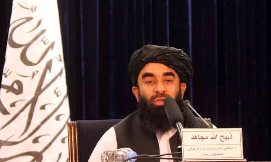 Zabiullah Mujahid speaks to the press in Kabul