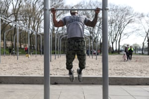 """Michael Howard, 32-years-old, works out at a park in Upper Manhattan. """"I'm a personal trainer, so the circumstances have me working out outside. My love and passion came from the park, so this gave me a chance to get back to it. I am training 25% of my clients virtually. Other than that, the rest of my work is on hold until the gyms open up. I come here four or five days a week depending on the weather. I wear my mask every time I come out because the news tell me to. It's for my safety and other people's safety. I don't want to put anyone at risk while I am working out."""""""