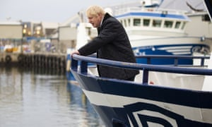 Boris Johnson on a fishing trawler during a visit to Peterhead in Scotland in September.