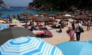 People enjoying sunny weather on Cala Aiguablava beach, amid the coronavirus disease (COVID-19) outbreak in Begur, near Girona, Costa Brava, Spain June 27, 2020.