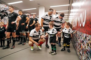 Barbarians captain Andy Ellis greets the mascots in the tunnel before the match.