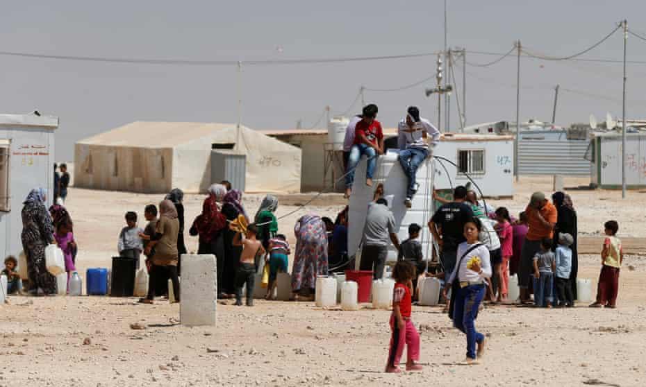 Syrian refugees collect water at the Za'atari refugee camp in Mafraq, Jordan.