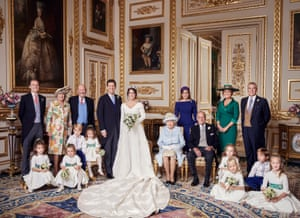 An official wedding photo of the couple released by the Royal Communications. With them in the back row, left to right: Thomas Brooksbank, Nicola Brooksbank, George Brooksbank, Princess Beatrice, Sarah, Duchess of York, the Duke of York. Middle row: Prince George of Cambridge, Princess Charlotte of Cambridge, Queen Elizabeth, Prince Philip, Maud Windsor, Louis De Givenchy. Front row: Theodora Williams, Mia Tindall, Isla Phillips, Savannah Phillips