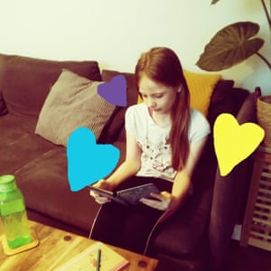 Esra, nine working in the living room