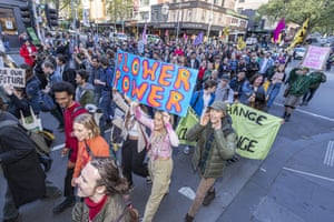Protesters marching along Bourke Street as part of an international call for two weeks of protests in Melbourne, Australia.