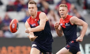 Tom McDonald of the Demons handballs during the round 14 AFL match between the Melbourne Demons and the Fremantle Dockers at Melbourne Cricket Ground.