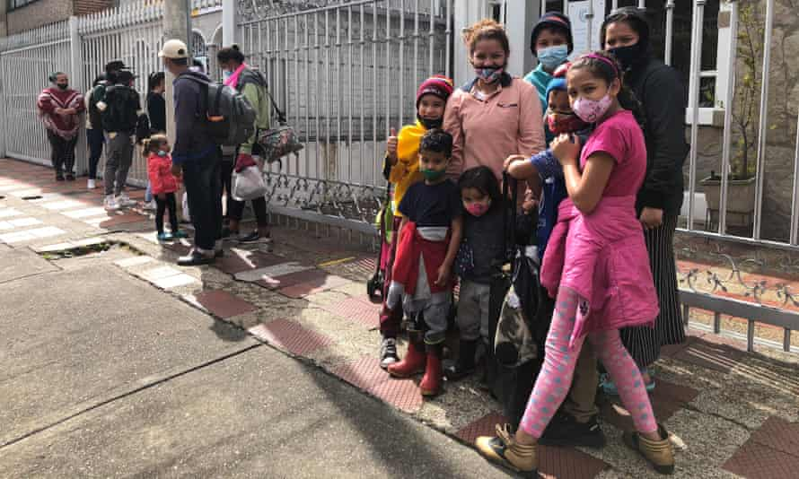 Beritza Colina, 30, waits with her children to be evaluated at a clinic for migrants in Bogotá.