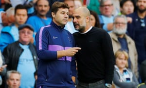 Mauricio Pochettino in conversation with Pep Guardiola on the touchline at the Etihad Stadium