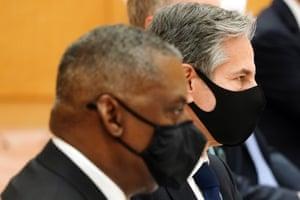 US defense secretary Lloyd Austin (L) and US secretary of state Antony Blinken (R) attend a meeting with Japanese prime minister Yoshihide Suga.