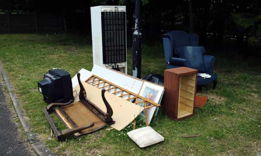 Rubbish awaiting collection including a TV, fridge and furniture