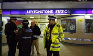 Police officers and crime scene investigators outside Leytonstone tube station in east London on Sunday