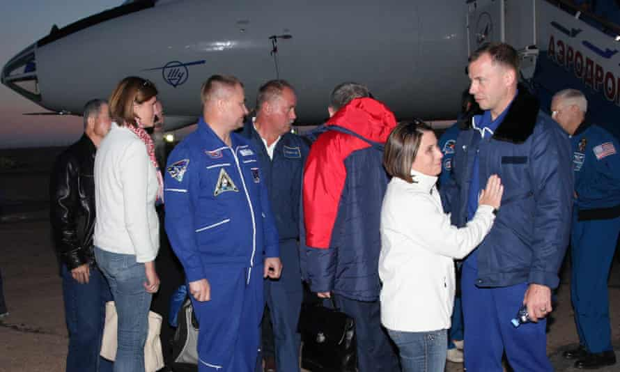 Russian cosmonaut Alexey Ovchinin (centre left) and Nasa astronaut Nick Hague (second right) arrive at Krayniy airport after their aborted launch in Baikonur, Kazakhstan, on Thursday.