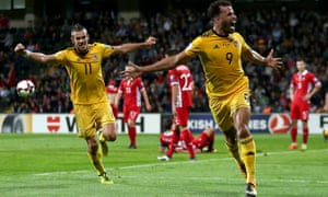 Hal Robson-Kanu celebrates after opening the scoring for Wales
