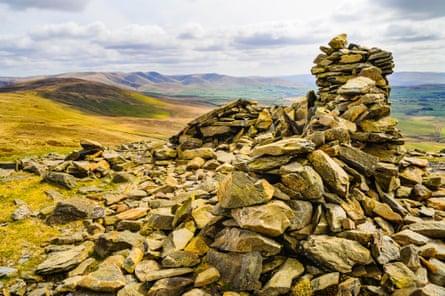 Summit cairn on Whinfell Beacon, looking towards Grayrigg Common and the Howgill Fells in the eastern Lake District
