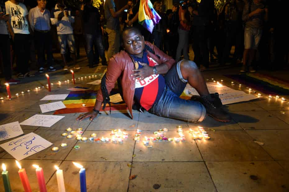 Moroccan activists participate in a vigil in Rabat to pay tribute to the victims of the Orlando gay club shooting.