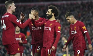 Mohamed Salah celebrates with teammates after scoring Liverpool's third goal against Southampton.