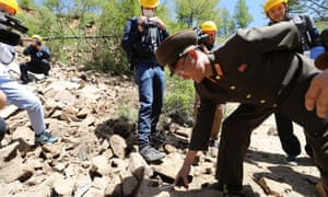 A North Korean soldier inspects debris following demolition of the Punggye-ri nuclear site on 24 May.