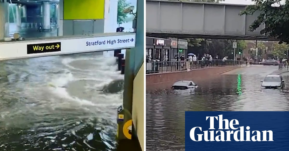 London flooding: vehicles stranded and tube stations submerged after thunderstorms – video
