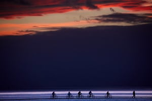 West Kirby, UK Cyclists ride around the marine lake on the coast of the Wirral peninsula
