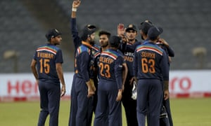 India celebrate the vital wicket of Jonny Bairstow, which sparked an England collapse.