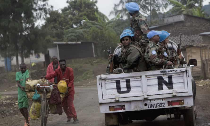 UN peacekeepers drive past Rutshuru residents in the eastern Democratic Republic of the Congo.