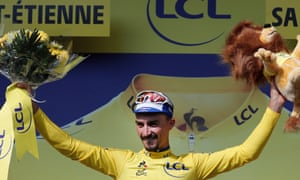 Julian Alaphilippe of Deceuninck – Quick Step  celebrates on the podium after reclaiming the overall Tour de France leader's yellow jersey in Saint-Étienne