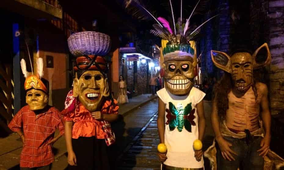 Parade hits … masked revellers at Xilitla's Xantolo celebrations.