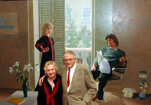 David Hockney stands in front of his painting Mr and Mrs Clark and Percy with Celia Birtwell