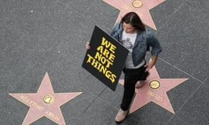 A demonstrator takes part in a #MeToo protest march for survivors of sexual assault and their supporters on the Hollywood Walk of Fame in Hollywood, Los Angeles, California, in 2017.