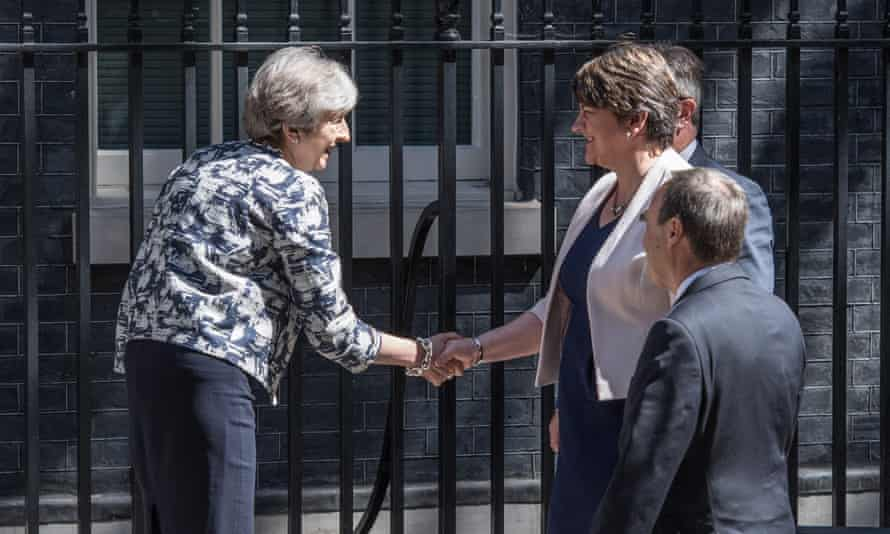 May and Foster shake hands outside Downing Street.
