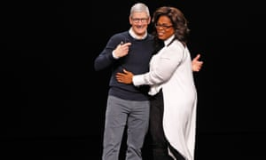 Namaste ... Tim Cook, CEO of Apple, and Oprah Winfrey hug during a special event at the Steve Jobs Theater in Cupertino.