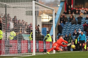 Nick Pope of Burnley saves the penalty.