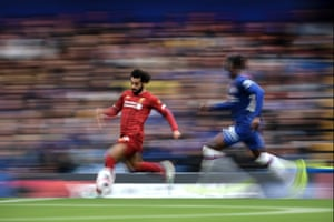 Mohamed Salah runs with the ball, chased by Fikayo Tomori.