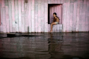 Anamã, Brazil A child looks at a street flooded by the rising Rio Solimões, one of the two main branches of the Amazon River.