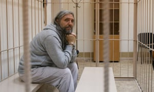 Sergei Torop sits in a cell at Novosibirsk central district court