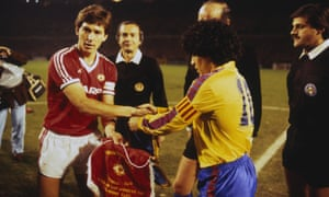 The Manchester United captain Bryan Robson shakes hands with the Barcelona captain Diego Maradona before the European Cup Winners' Cup quarter-final second leg.