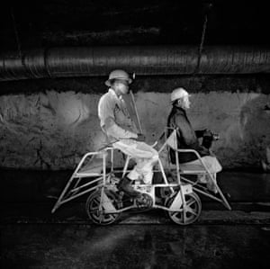 Team leader  and mine captain on a pedal car, Rustenburg platinum mine, 1971