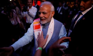 Narendra Modi greets attendees at an event ahead of the G20 summit in Buenos Aires