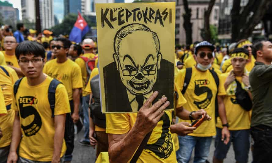 A protester holds a caricature ofMalaysia's prime minister Najib Razak during a rally in Kuala Lumpur.