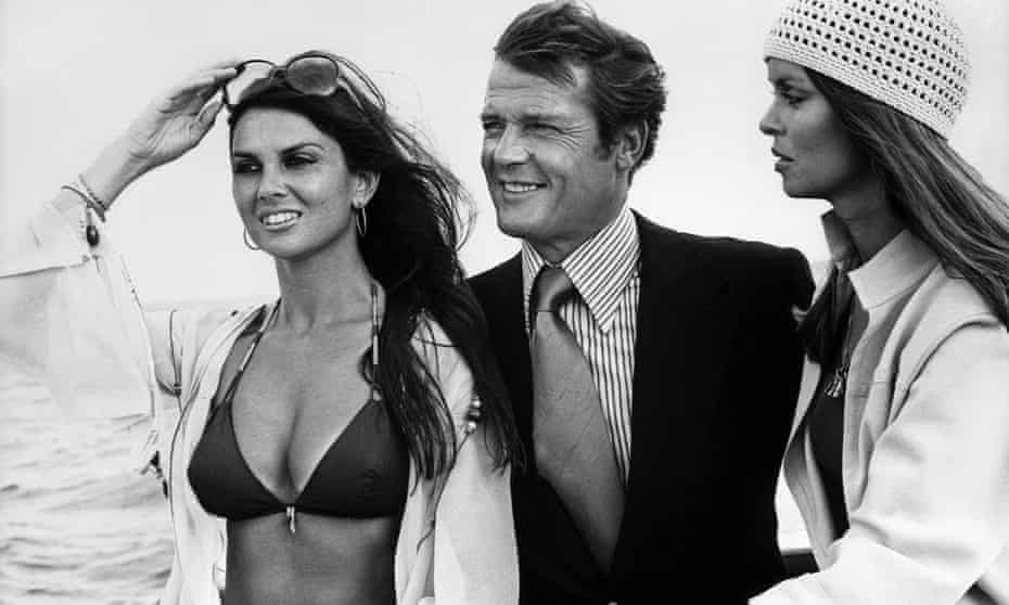 Munro (left) with Roger Moore and Barbara Bach on the Set of The Spy Who Loved Me.