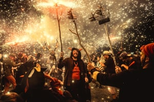 Barcelona, Spain Fire runners dance to traditional drums during the Major de Gràcia