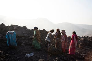 Women scavenge for coal on one of Jharia's many state-owned coal mines